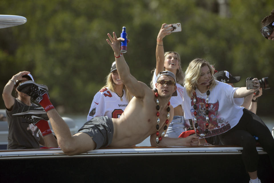 Tampa Bay Buccaneers NFL football tight end Rob Gronkowski waves during a celebration of their Super Bowl 55 victory over the Kansas City Chiefs with a boat parade in Tampa, Fla., Wednesday, Feb. 10, 2021. (AP Photo/Phelan Ebenhack)