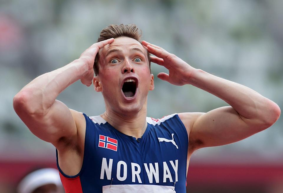 Karsten Warholm of Norway celebrates after the Men's 400m Hurdles Final at the Tokyo 2020 Olympic Games.