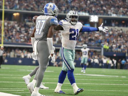 Sep 30, 2018; Arlington, TX, USA; Dallas Cowboys running back Ezekiel Elliott (21) celebrates a late fourth quarter catch for first down against Detroit Lions safety Tracy Walker (47) at AT&T Stadium. Mandatory Credit: Matthew Emmons-USA TODAY Sports