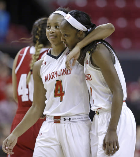 Maryland guard Lexie Brown (4) embraces teammate Laurin Mincy in the final moments of an NCAA college basketball game against Indiana, Thursday, Feb. 26, 2015, in College Park, Md. Mincy contributed a game-high 28 points to Maryland's 83-72 win. (AP Photo/Patrick Semansky)