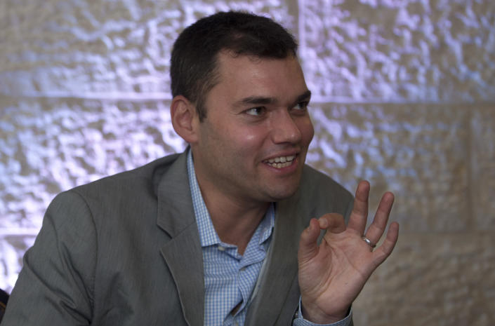 FILE - In this June 21, 2012, file photo, Peter Beinart, a prominent Jewish-American commentator speaks during an interview with The Associated Press in Jerusalem. Beinart has shocked the Jewish establishment and Washington policy-making circles by breaking a long-standing taboo: He has endorsed the idea of a democratic entity of Jews and Palestinians living with equal rights between the Jordan River and the Mediterranean. (AP Photo/Sebastian Scheiner, File)