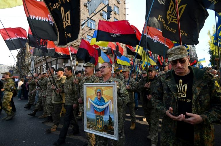 """Protesters chanted """"No to capitulation!"""", """"Ukraine above all"""" as thousands marched in Kiev against a possible pullback of troops fighting Moscow-backed separatists in the east of the country (AFP Photo/GENYA SAVILOV)"""