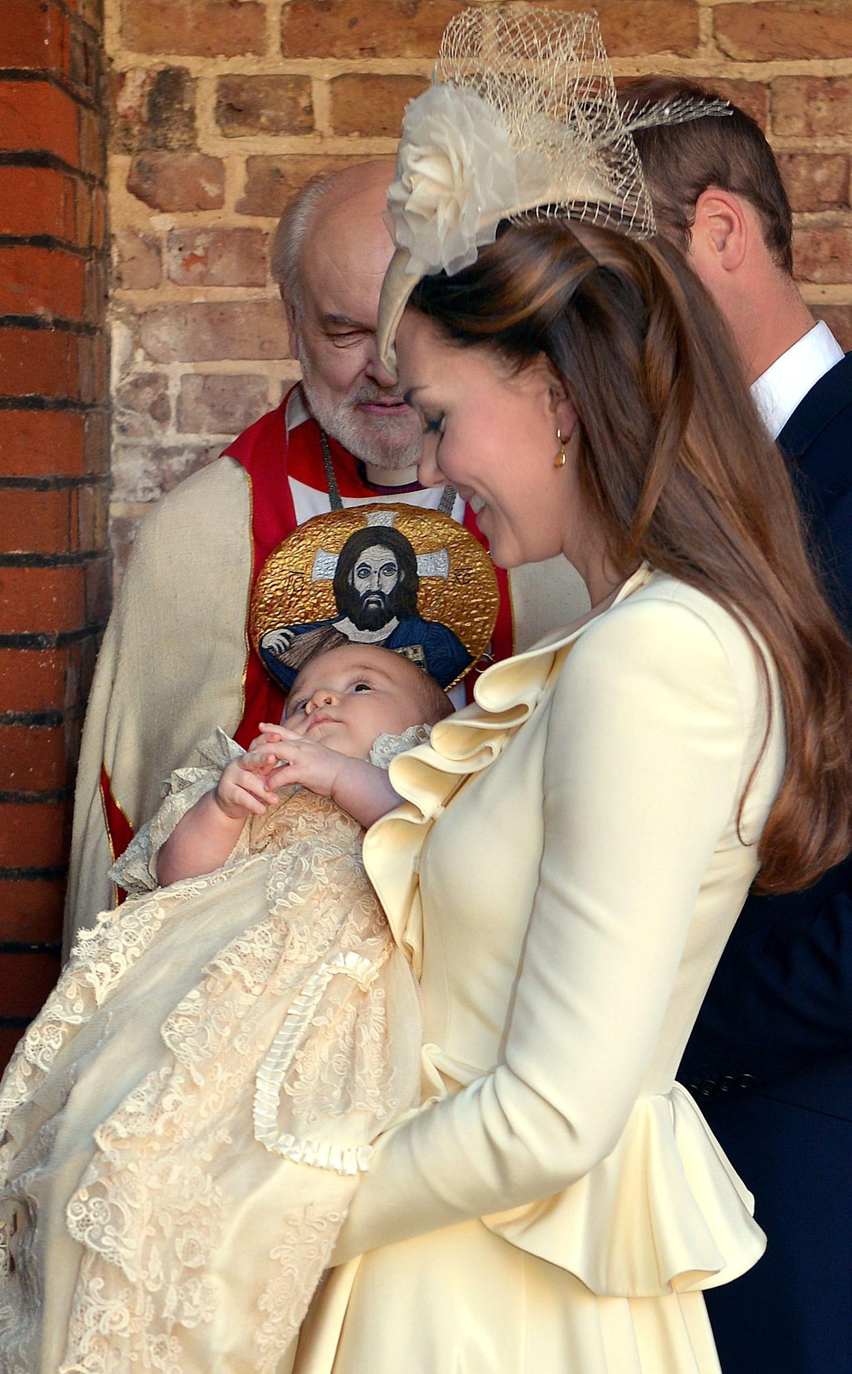 The Duchess of Cambridge carries her son Prince George following his christening at the Chapel Royal in St James's Palace by the Archbishop of Canterbury in central London.