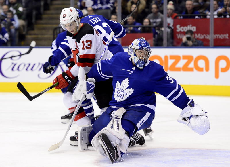 CORRECTS THAT A GOAL WAS SCORED ON THE PLAY - Toronto Maple Leafs goaltender Frederik Andersen (31) looks back at a goal, next to New Jersey Devils center Nico Hischier (13) during the third period of an NHL hockey game Tuesday, Jan. 14, 2020, in Toronto. (Frank Gunn/The Canadian Press via AP)