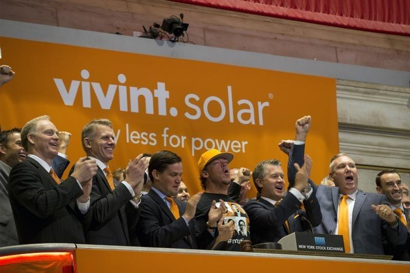 Vivint Solar CEO Butterfield and members of the company's management team ring the opening bell at the New York Stock Exchange