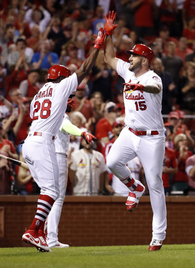 St. Louis Cardinals' Matt Adams (15) is congratulated by teammate Adolis Garcia (28) after hitting a three-run home run during the eighth inning of a baseball game against the Pittsburgh Pirates Monday, Sept. 10, 2018, in St. Louis. (AP Photo/Jeff Roberson)