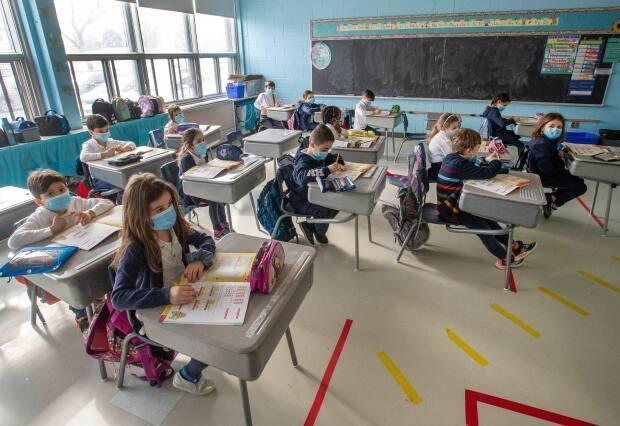 Elementary and high school students in Montreal, Laval, the South Shore and several other parts of the province will once again be required to wear a mask while seated in class this fall.  (Ryan Remiorz/The Canadian Press - image credit)