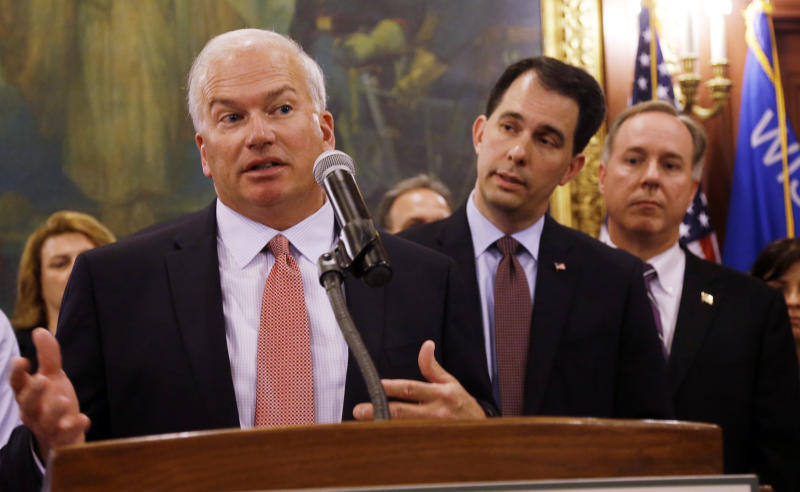 Wisconsin state Senate President Scott Fitzgerald (left), Gov. Scott Walker (center) and Assembly Speaker Robin Vos -- all Republicans -- have led an effort to rein in the powers of statewide offices that Democrats won from the GOP in November. (ASSOCIATED PRESS)