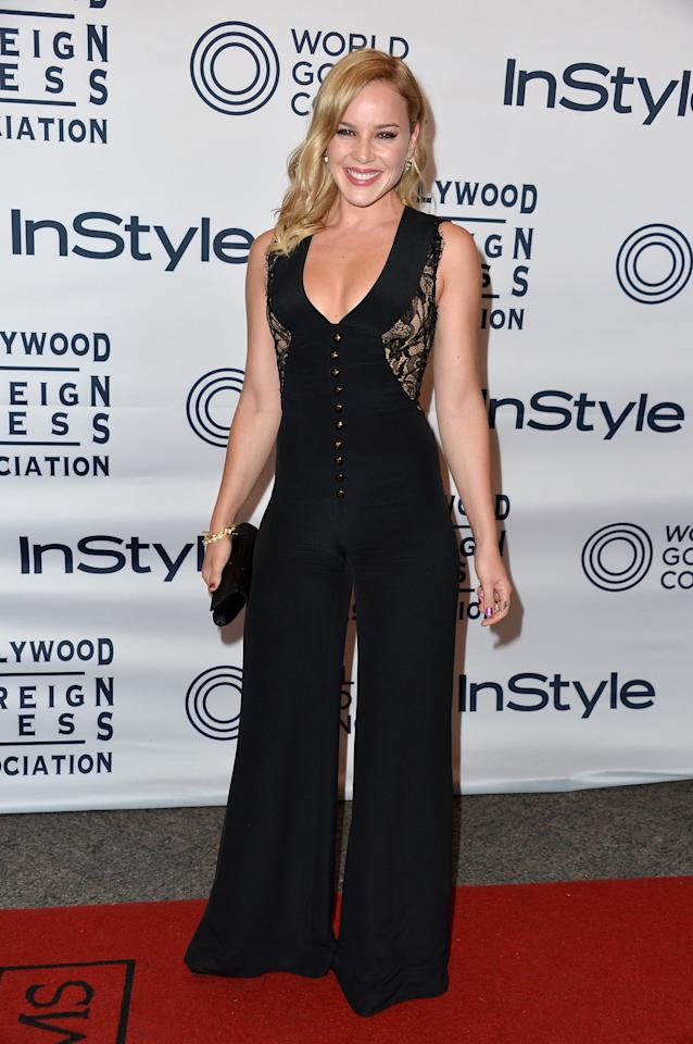 lot more if it had been a long dress instead. But then we realized how rare it is to see an actress in pants at any red carpet event, let alone at the Toronto International Film Festival. So now, we admire her moxie. You go, Abbie Cornish!