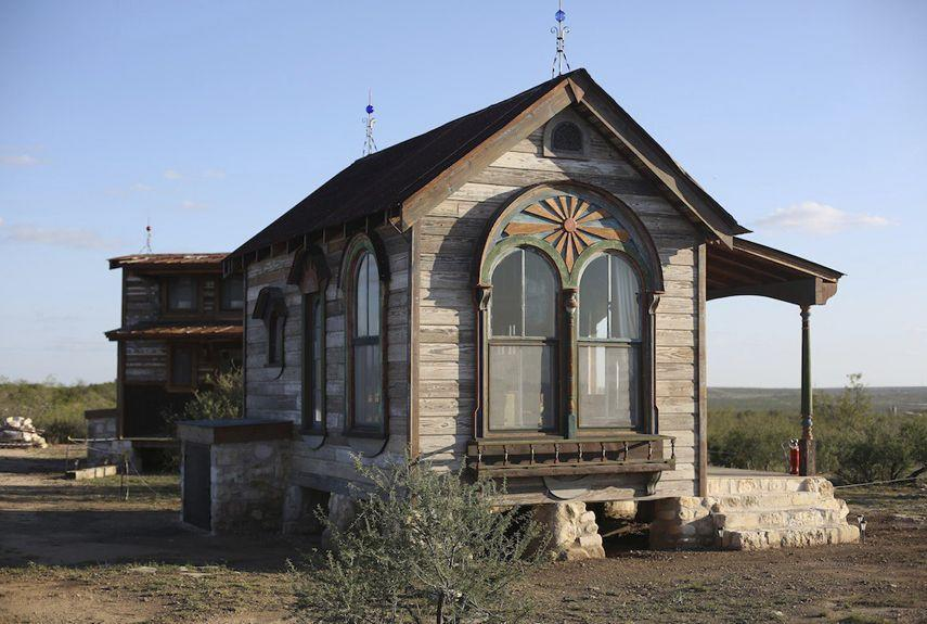 """<p>Made from 95 percent salvaged materials, the Arched Zebu is a tiny prairie house from <a href=""""http://tinytexashouses.com/"""" rel=""""nofollow noopener"""" target=""""_blank"""" data-ylk=""""slk:Tiny Texas Houses"""" class=""""link rapid-noclick-resp"""">Tiny Texas Houses</a>. Measuring 12- by 18-feet, the house is built from materials that are close to 200 years old. Featuring beautiful arched windows, the cottage includes a lofted sleep area, kitchen, and shabby chic details.</p><p><a class=""""link rapid-noclick-resp"""" href=""""http://puresalvageliving.com/the-zebu-sisters-home-on-the-prairie-shots/"""" rel=""""nofollow noopener"""" target=""""_blank"""" data-ylk=""""slk:SEE INSIDE"""">SEE INSIDE</a></p>"""