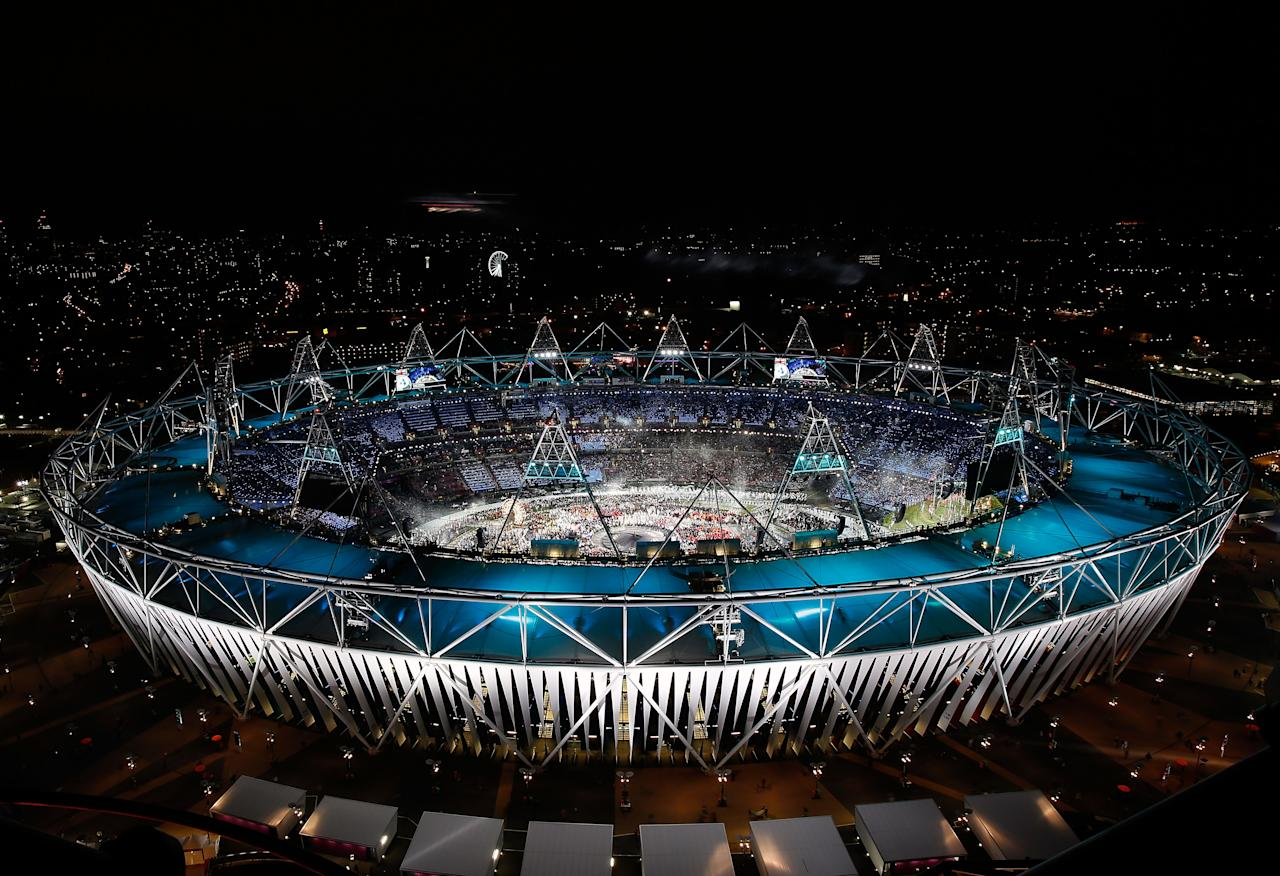 LONDON, ENGLAND - JULY 27:  A helicopter flies above the olympic stadium as Team Great Britain walks in during the Opening Ceremony for the 2012 Olympic Games on July 27, 2012 at Olympic Park in London, England.  (Photo by Jamie Squire/Getty Images)