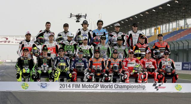 MotoGP riders pose for a group photo before the start of the free practice session of the MotoGP World Championship at the Losail International circuit in Doha March 20, 2014. REUTERS/Fadi Al-Assaad (QATAR - Tags: SPORT MOTORSPORT)