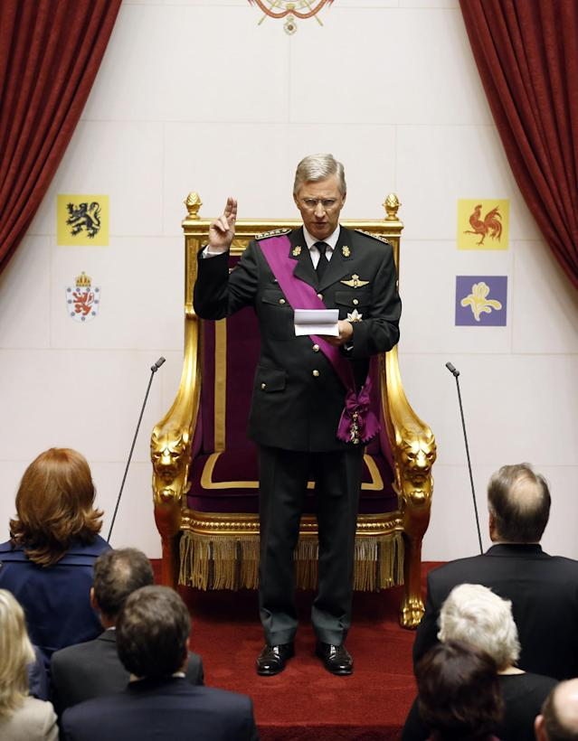 Belgium's Prince Philippe takes the oath at the Palace of the Nation in Brussels on Sunday, July 21, 2013. Philippe has taken the oath before parliament to become Belgium's seventh king after his father Albert II abdicated as the head of this fractured nation. Earlier Sunday, the 79-year-old Albert signed away his rights as the kingdom's largely ceremonial ruler at the royal palace in the presence of Prime Minister Elio Di Rupo, who holds the political power in this 183-year-old parliamentary democracy. (AP Photo/Bruno Fahy)
