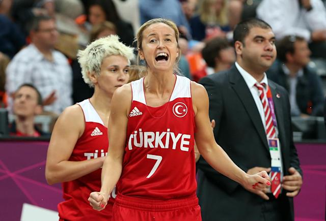 LONDON, ENGLAND - JULY 30: Nilay Kartaltepe #7 of Turkey celebrates on the bench in the final moments of the Women's Preliminary Round match against Czech Republic on Day 3 at Basketball Arena on July 30, 2012 in London, England. (Photo by Christian Petersen/Getty Images)