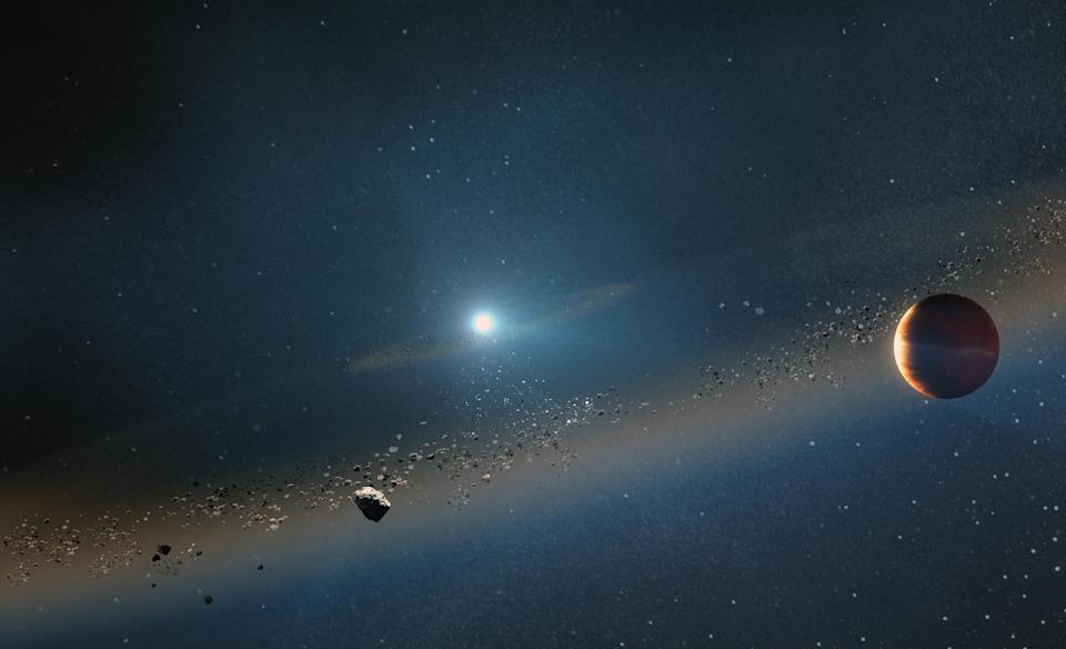 An artist's concept of a debris ring emanating from the sun as it collapses into a white dwarf in five or so billion years. (W. M. Keck Observatory/Adam Makarenko via The New York Times)