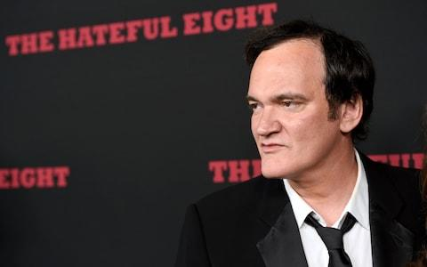 "Quentin Tarantino arrives at the Los Angeles premiere of ""The Hateful Eight"" at the Cinerama Dome on Monday, Dec. 7, 2015 - Credit: AP"