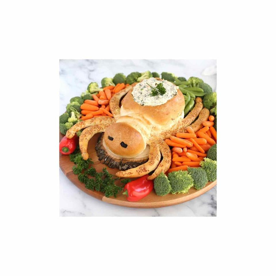 """<p>With a little manipulation, you can turn store-bought frozen dinner rolls into a Pinterest-worthy and crowd-pleasing appetizer. </p><p><a class=""""link rapid-noclick-resp"""" href=""""https://www.itsalwaysautumn.com/spider-bread-dip-bowl-fun-halloween-appetizer-idea.html"""" rel=""""nofollow noopener"""" target=""""_blank"""" data-ylk=""""slk:GET THE RECIPE"""">GET THE RECIPE</a> </p>"""