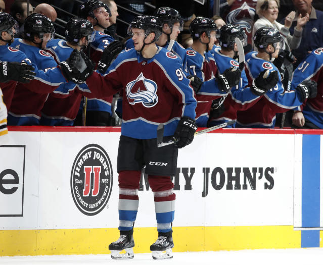 Colorado Avalanche right wing Mikko Rantanen is congratulated for his goal as he passes the team box during the second period of an NHL hockey game against the Boston Bruins on Wednesday, Nov. 14, 2018, in Denver. (AP Photo/David Zalubowski)