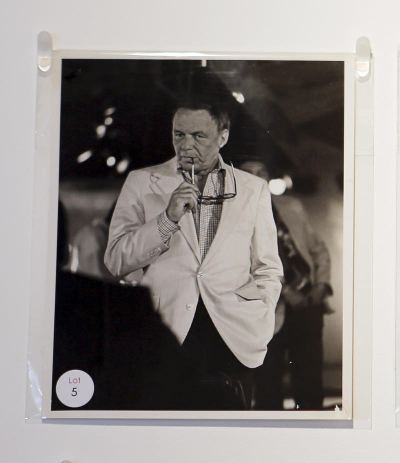 This Jan. 16, 2013 image shows a photograph of the late Frank Sinatra, owned by Studio 54 club co-founder Steve Rubell, on display in West Palm Beach, Fla.Memorabilia from the famed 1970s club is hitting the auction block in Florida. The private collection of co-founder Steve Rubell is being sold Saturday in West Palm Beach. (AP Photo/Alan Diaz)