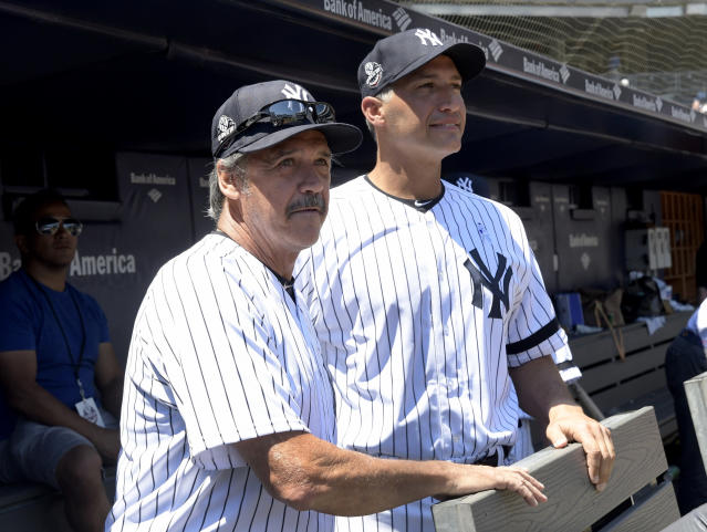 New York Yankees' Ron Guidry, left. and Andy Pettitte look on from the dugout before the Yankees Old Timers' Day baseball game Sunday, June 17, 2018, at Yankee Stadium in New York. (AP Photo/Bill Kostroun)