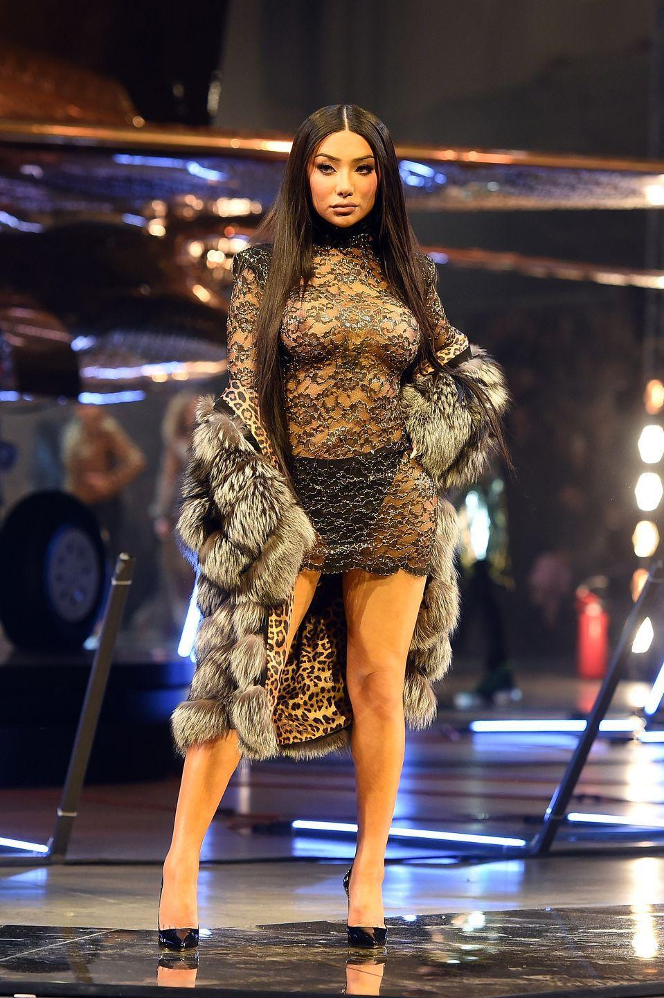"""<p>She might have <a href=""""https://www.seventeen.com/fashion/celeb-fashion/a31076576/nikita-dragun-tripped-on-the-philipp-plein-runway-at-fashion-week/"""" rel=""""nofollow noopener"""" target=""""_blank"""" data-ylk=""""slk:tripped during the rehearsal"""" class=""""link rapid-noclick-resp"""">tripped during the rehearsal</a>, but during the Philipp Plein fashion show, Nikita SLAYED. She wore nothing but a sheer lace dress and black panties with a lux-as-hell fur coat. Truly, your fave could never. </p>"""