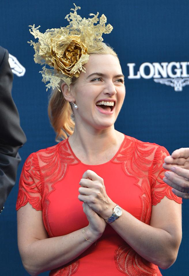 HONG KONG - DECEMBER 09: Actress Kate Winslet (guest of Longines) smiles during The presentation of The Longines Hong Kong Cup during the Hong Kong International Races at Sha Tin racecourse on December 9, 2012 in Hong Kong.  (Photo by Vince Caligiuri/Getty Images)