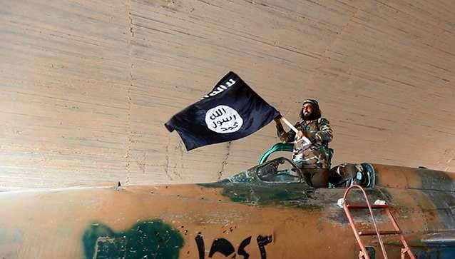 """Image 1: <p>The Islamic State flag, which is black and features white text saying """"There is no God but Allah"""". Photo: AP"""