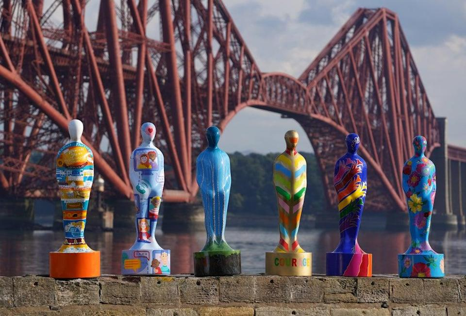 Some of the sculptures from the art installation Gratitude at The Forth Bridge at North Queensferry (Andrew Milligan/PA) (PA Wire)