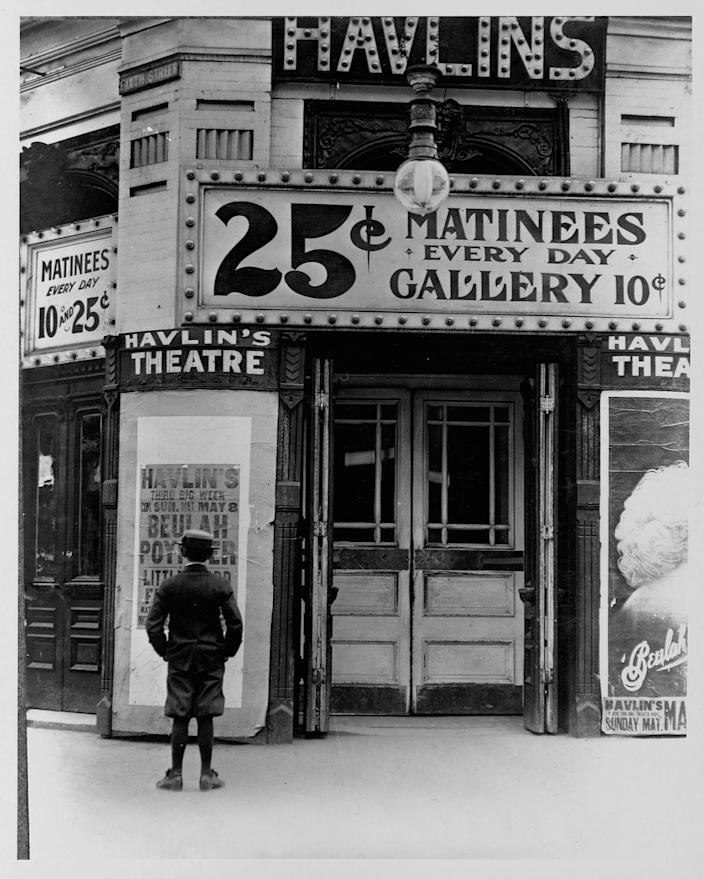 <p>A boy stands outside Havlin's Theatre in 1910. It was heavily damaged by a tornado in 1896.<br></p>