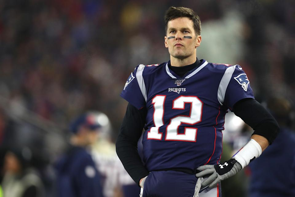 Tom Brady is the most sought-after free agent on the market, but an uncertain offseason schedule could present a risk to teams that want to gamble on the veteran quarterback. (Photo by Maddie Meyer/Getty Images)