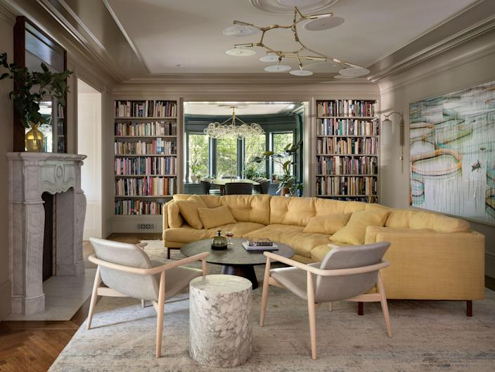 The beloved yellow sofa was upholstered in fabric by Rodgers & Goffigon, thanks to Acanthus Upholstery. The rug is from ABC Carpet & Home and the light fixture is by Lindsey Adelman.