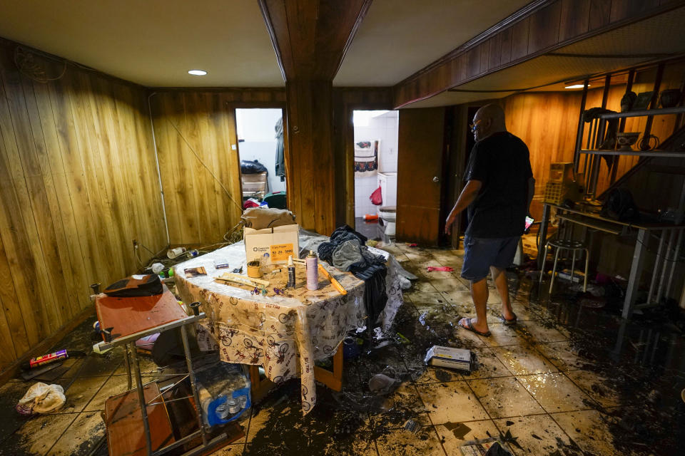 Felix Delapuente, a neighbor fo the home in the Queens borough of New York where some of the occupants died including a 2-year old child, shows the flood damage in his basement, Thursday, Sept. 2, 2021, in New York. The remnants of Hurricane Ida dumped historic rain over New York City, with several deaths linked to flooding in the region as basement apartments suddenly filled with water and freeways and boulevards turned into rivers, submerging cars.(AP Photo/Mary Altaffer)