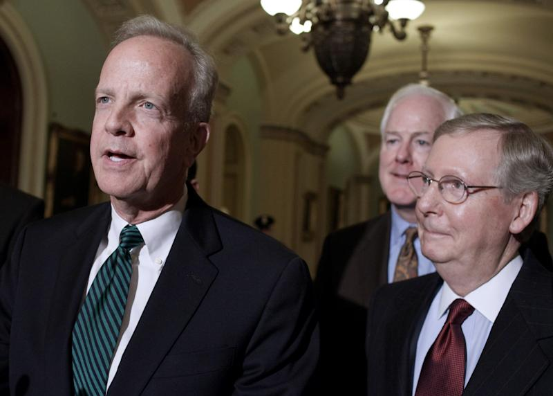 GOP divide surfaces early in 2014 Senate contest