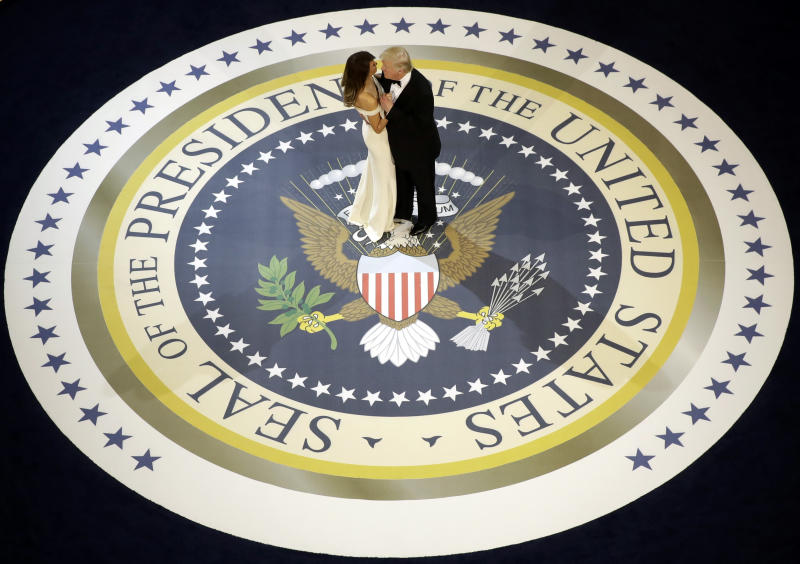 FILE - In this Jan. 20, 2017, file photo, President Donald Trump dances with first lady Melania Trump at The Salute To Our Armed Services Inaugural Ball. (AP Photo/Evan Vucci, File)
