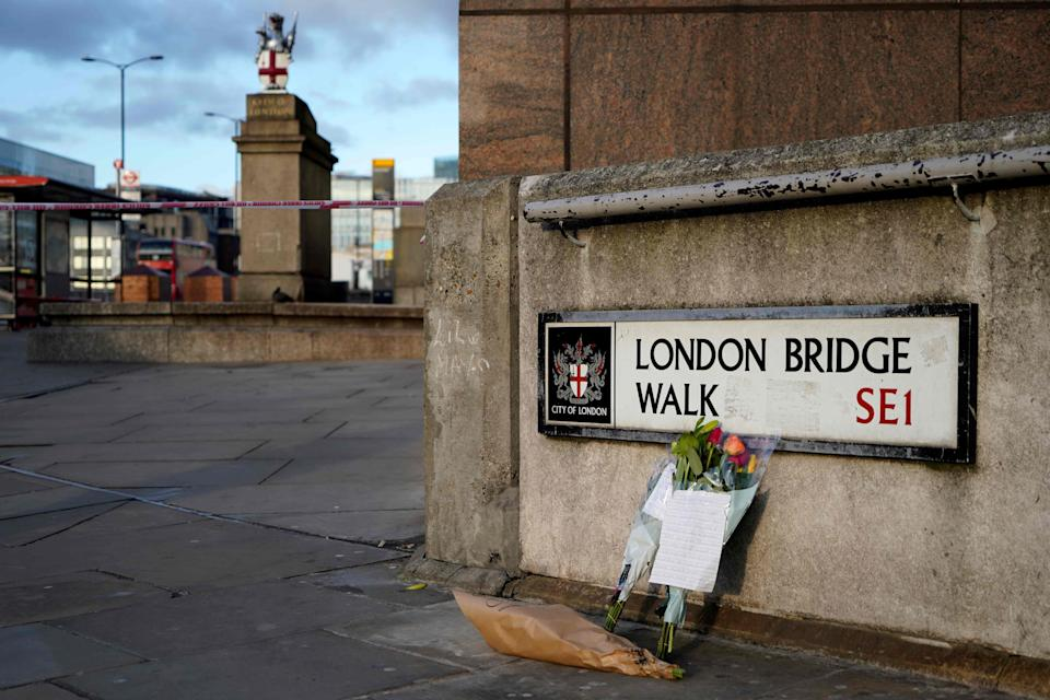 <p>A floral tribute near the scene of last year's terror attack</p> (AFP via Getty Images)