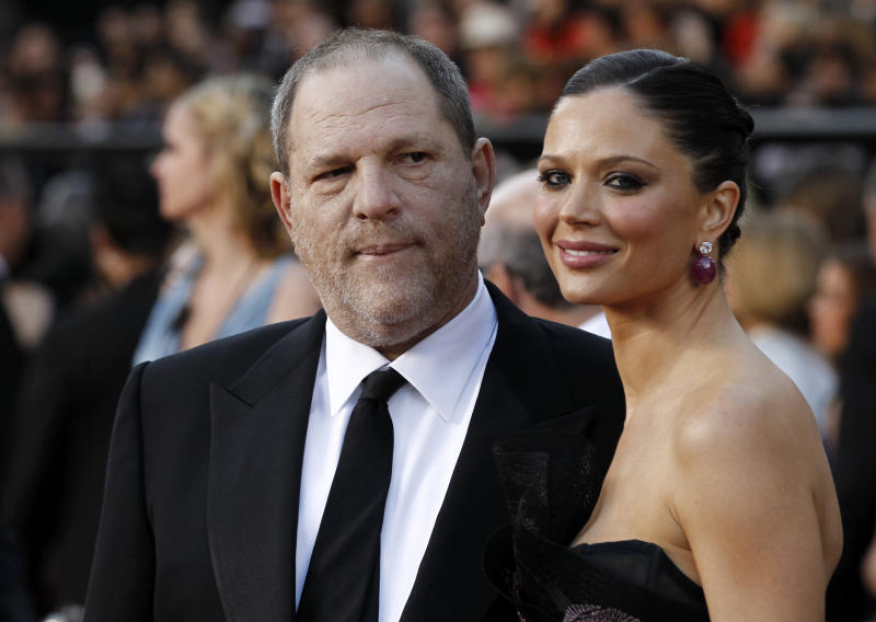 Harvey Weinstein and wife Georgina Chapman arrive before the 83rd Academy Awards on Sunday, Feb. 27, 2011, in the Hollywood section of Los Angeles. (AP Photo/Matt Sayles)