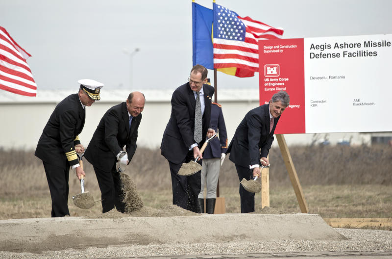 From left US Vice Admiral James D Syring, Romanian President Traian Basescu , US Undersecretary of Defense for Policy James N Miller, and Romanian Defense Minister Mircea Dusa shovel sand during the official ground breaking ceremony of an U.S. Aegis Ashore missile defense base in Deveselu, Romania, Monday, Oct. 28, 2013. US and Romanian officials marked the start of construction work at a Romanian air force base in southern Romania that will host radar and interceptor missile systems, part of the US-NATO missile shield for Europe.(AP Photo/Vadim Ghirda)