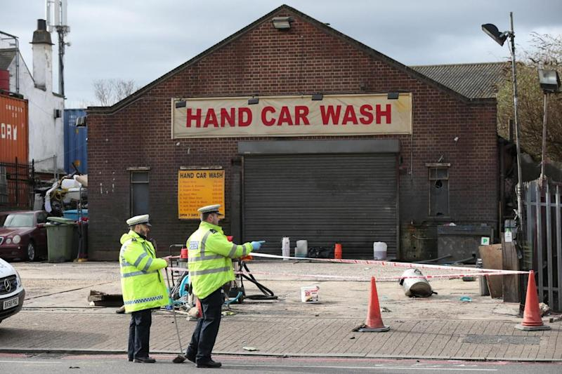 Investigation: Police outside the car wash (PA)