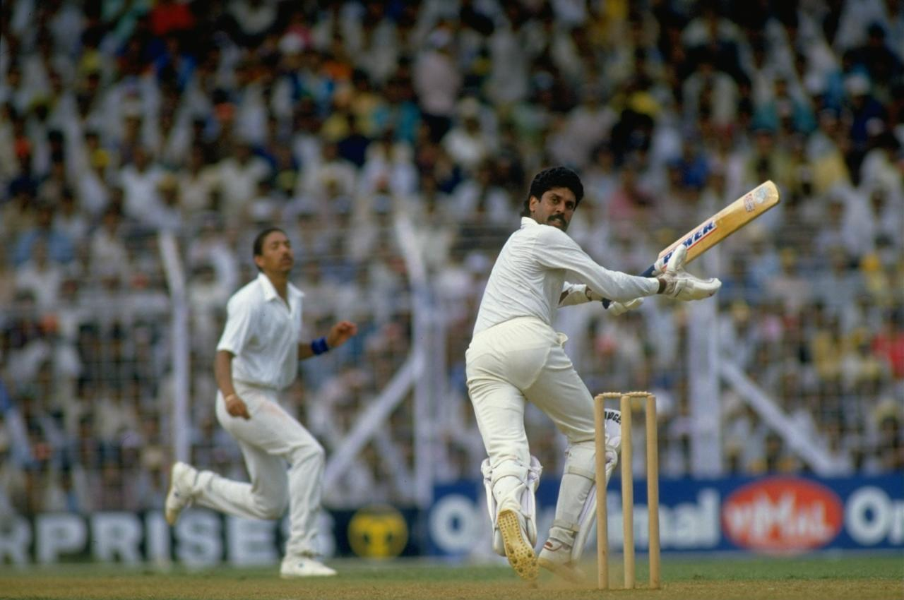 1987:  Kapil Dev of India in action during the World Cup semi-final against England at Wankhede Stadium in Bombay, India. \ Mandatory Credit: Adrian  Murrell/Allsport