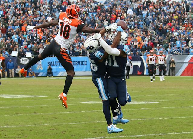 <p>Logan Ryan #26 and Kevin Byard #31 collide with one another defending against A.J. Green #18 of the Cincinnatti Bengals during the second half at Nissan Stadium on November 12, 2017 in Nashville, Tennessee. (Photo by Frederick Breedon/Getty Images) </p>