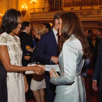 <b>Kate Middleton outdone by Michelle Obama</b><br><br>She could have made a grand splash at the London Games' Opening Ceremony. Instead, the Duchess of Cambridge toned it down with an icy blue Christopher Kane coat-dress. (At least she wore a British designer!) <br>First Lady Michelle Obama outshone Kate at a cocktail reception in Buckingham Palace in a white flowing gown by J. Mendel accentuated by silver embroidery. Regardless who you think won the style-off, both women look very chic. (Photo by Dominic Lipinski - WPA Pool/Getty Images)