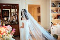 Still at my mom's—I'm taking one final look at myself before leaving! My older brother, Derek, was there too, and he drove me down the block to the wedding and walked me down the aisle moments after this photo. Everyone else was at the ceremony by this point.