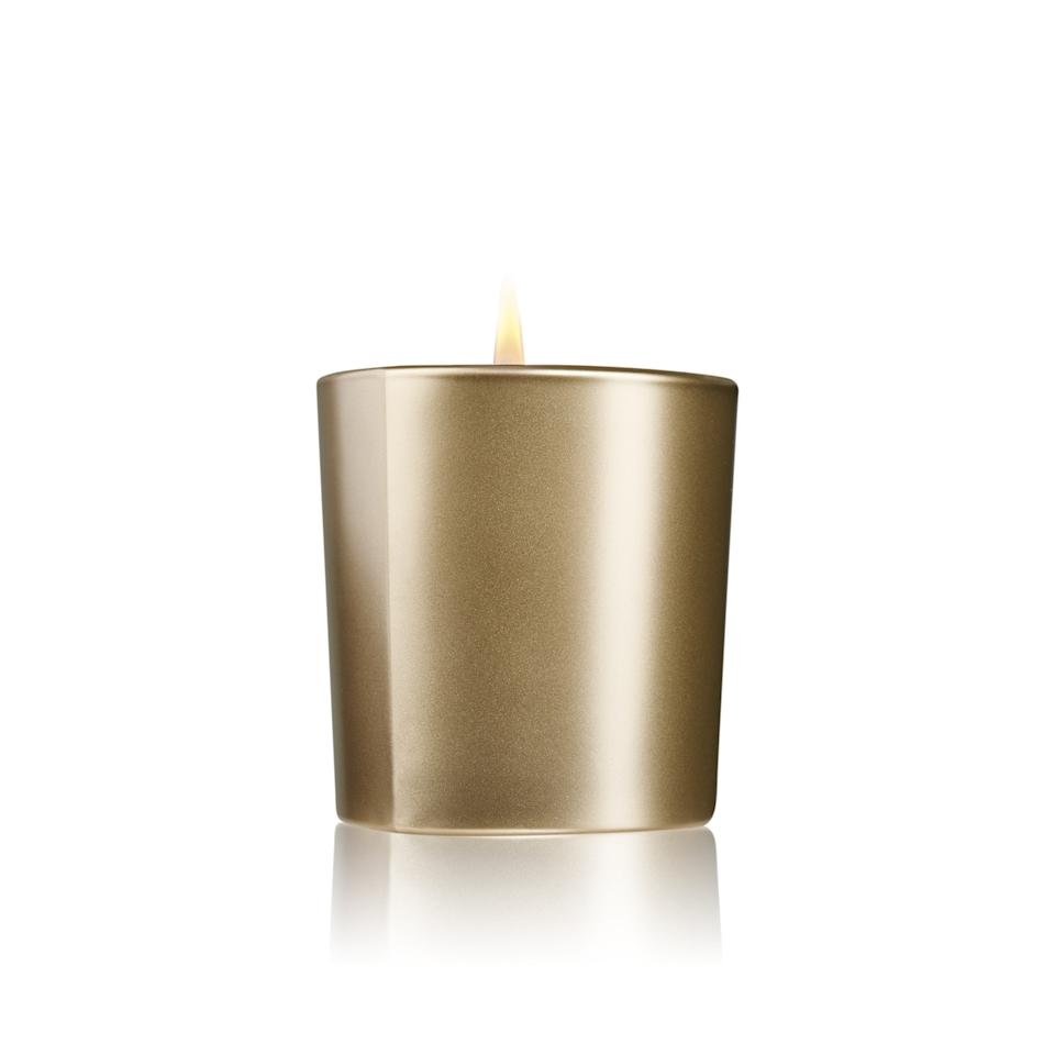 "<p>Not only does this candle look like a brick of solid gold, but it feels like one, too. As for the scent, it's based all around the Damask rose, blending the seductive floral with warm and spicy notes of saffron, amber, and patchouli.</p> <p>$90 (<a rel=""nofollow"" href=""http://www.giorgioarmanibeauty-usa.com/armani-prive-candle-rose-d-arabie/A593.html?mbid=synd_yahoobeauty"">giorgioarmanibeauty-usa.com</a>)</p>"