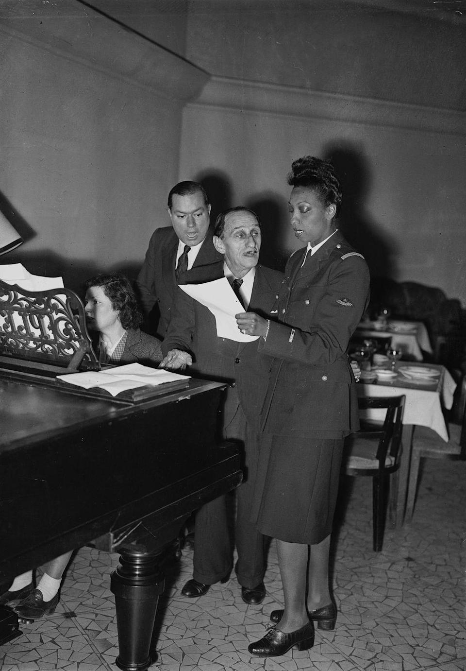 """<p>Baker was <a href=""""https://www.britannica.com/biography/Josephine-Baker"""" rel=""""nofollow noopener"""" target=""""_blank"""" data-ylk=""""slk:awarded the Croix de Guerre"""" class=""""link rapid-noclick-resp"""">awarded the Croix de Guerre</a> and the Legion of Honour for her work as a member of the French Résistance after the war. The singer <a href=""""https://www.biography.com/performer/josephine-baker"""" rel=""""nofollow noopener"""" target=""""_blank"""" data-ylk=""""slk:transported secret messages for the Résistance in her sheet music"""" class=""""link rapid-noclick-resp"""">transported secret messages for the Résistance in her sheet music</a> and was recognized as a war hero.</p>"""