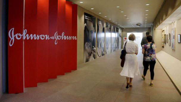 PHOTO: People walk along a corridor at the headquarters of Johnson & Johnson in New Brunswick, N.J., July 30, 2013. (Mel Evans/AP, FILE)
