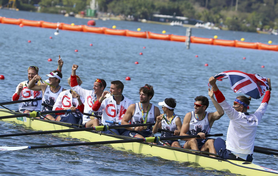<p>Scott Durant, Tom Ransley, Andrew Triggs-Hodge, Matthew Gotrel, Pete Reed, Paul Bennett, Matt Langridge, William Satch, and Phelan Hill of Britain row away with their gold medals after the men's eight rowing final at Lagoa Stadium in Rio on August 13, 2016. (REUTERS/Murad Sezer) </p>