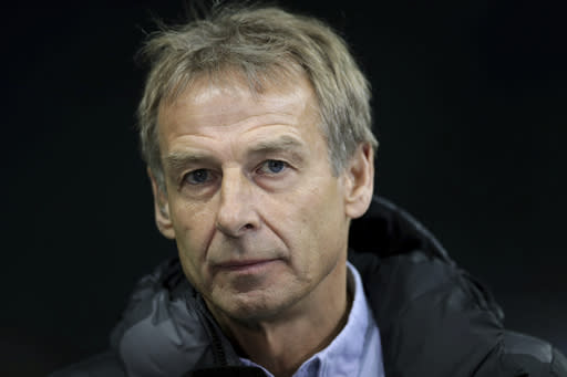 In this Saturday, Dec. 21, 2019 photo Hertha's head coach Juergen listens to a reporter's question during an interview prior to the German Bundesliga soccer match between Hertha BSC Berlin and Borussia Moenchengladbach in Berlin, Germany. (AP Photo/Michael Sohn)