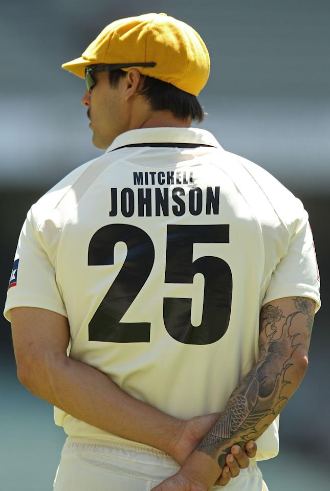 MELBOURNE, AUSTRALIA - NOVEMBER 20:  A tattoo adorns the arm of Mitchell Johnson as he looks on in the field during day four of the Sheffield Shield match between the Victorian Bushrangers and the Western Australia Warriors at Melbourne Cricket Ground on November 20, 2010 in Melbourne, Australia.  (Photo by Scott Barbour/Getty Images)