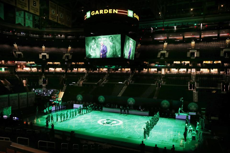 The Boston Celtics and the Brooklyn Nets observe a moment of silence for K.C. Jones before an NBA basketball game, Friday, Dec. 25, 2020, in Boston. Basketball Hall of Famer K.C. Jones, who won eight NBA championships as a Celtics player in the 1960s and two more as the coach of the Boston team that took the titles in 1984 and '86, has died. He was 88. (AP Photo/Michael Dwyer)