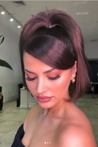 <p>This vintage ponytail hairstyle has been making a major comeback. Leave out a chunky portion of hair at the front to sweep to the side in a grand fashion, pull that ponytail up high, and flip out the ends with your straightening iron.</p>